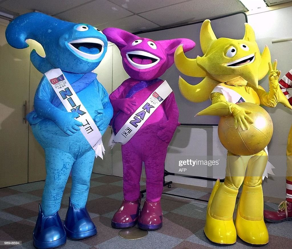 Three mascots of the 2002 World Cup Korea-Japan pose for photographers in Seoul 26 April 2001. Korean organizing committee for the 2002 World Cup announced the three mascots names 'Nik' (blue one), 'Kaz' (purple), 'Ato' (yellow) Thursday. AFP PHOTO