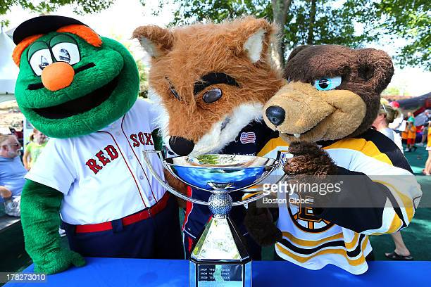 Three mascots pondered drinking out of the FedEx Cup in the children's play area Boston Red Sox's Wally New England Revolution's Slyde and Boston...