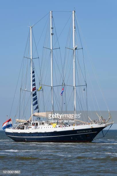 Three masted schooner Eendracht from The Netherlands entering the port of Harlingen during the finish of the 2018 Tall Ship Race on August 3 2018 in...