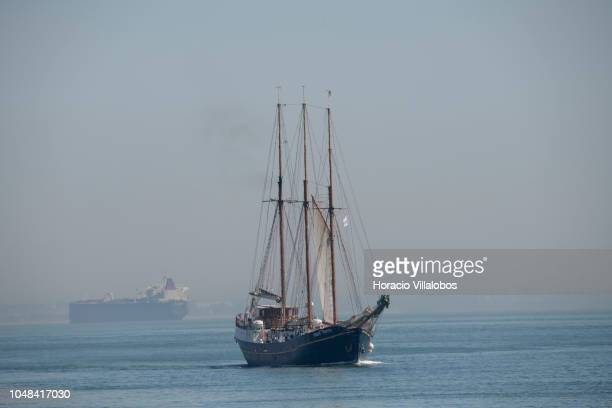 Three masted topsail steel schooner 'Príncipe Perfeito' sails with tourists on the Tagus River near 25 de Abril bridge on October 01 2018 in Lisbon...