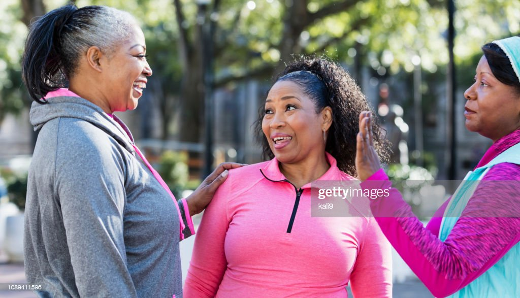 Three mature African-American women conversing : Stock Photo