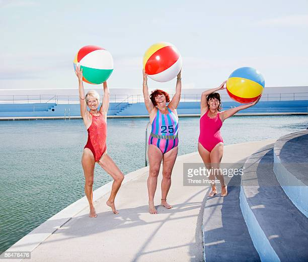 three mature ladies posing at the pool - old woman in swimsuit stock pictures, royalty-free photos & images