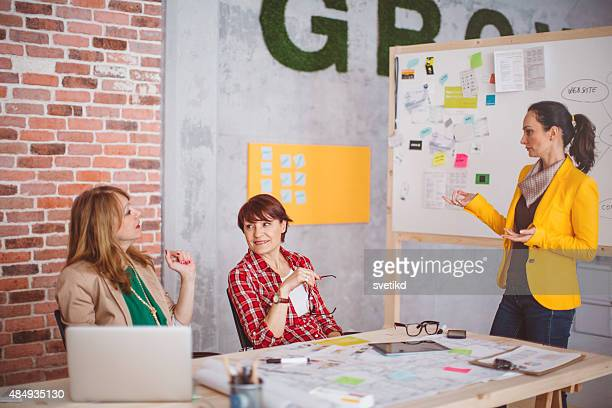 Three mature woman working in office.