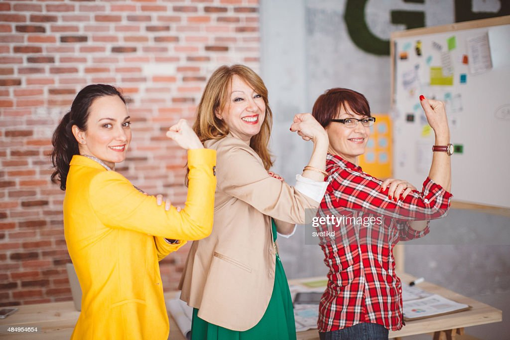 Three mature woman working in office. : Stock Photo