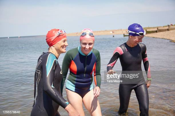 three mature women having fun in sea - leisure activity stock pictures, royalty-free photos & images