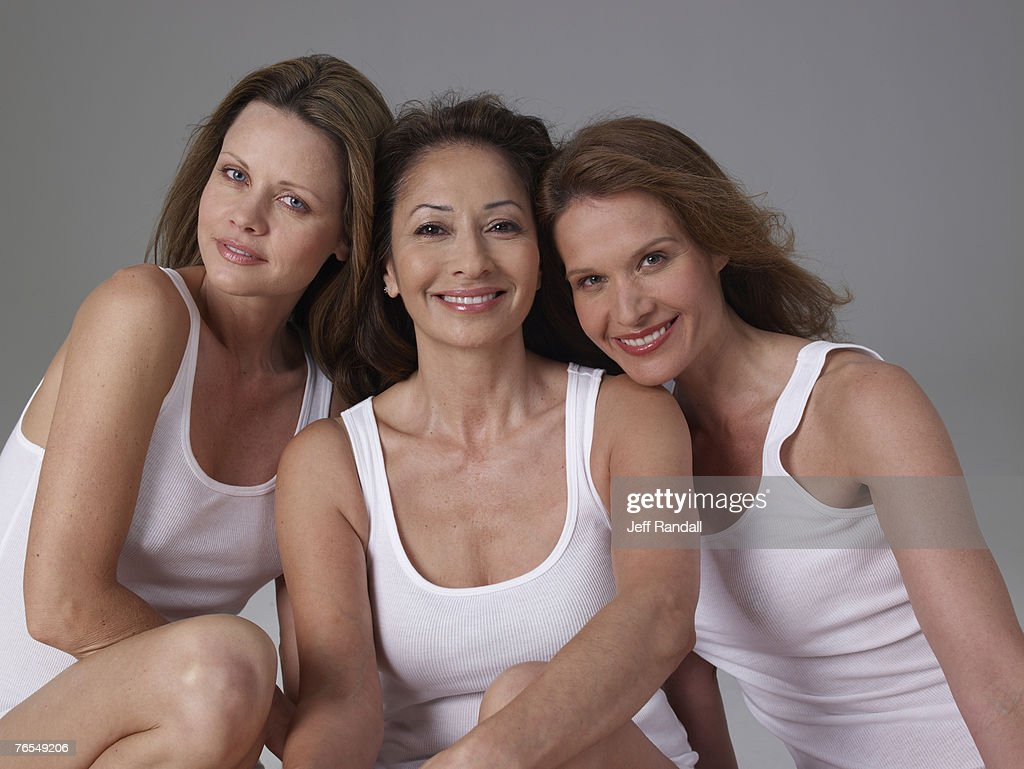 Three mature women, smiling, portrait : Stock Photo
