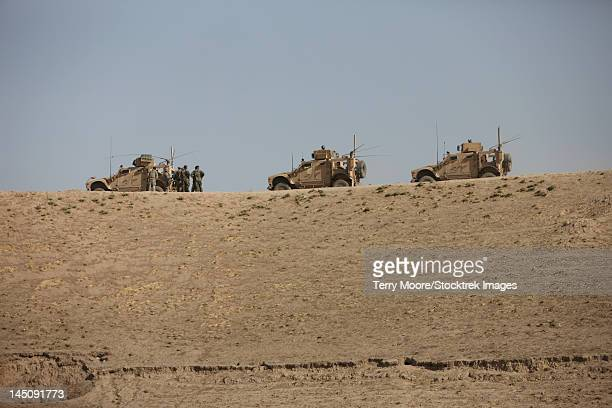 three m-atv's guard the top of the wadi near kunduz, afghanistan. - glen ridge officer stock pictures, royalty-free photos & images