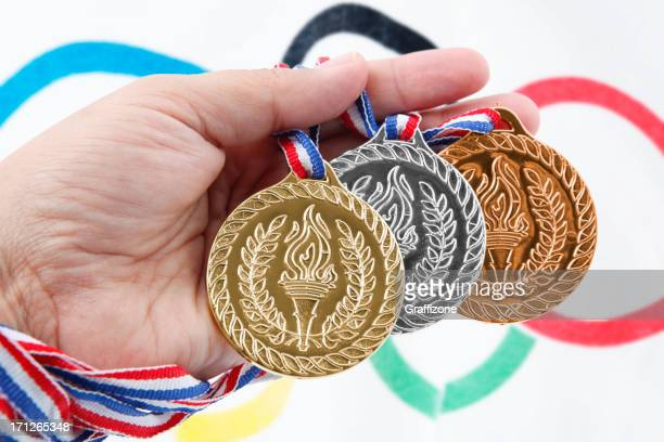 three medals with olympic flag - the olympic games stock pictures, royalty-free photos & images