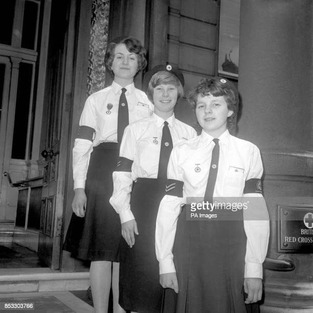 Three members of the British Junior Red Cross who by the courtesy of their patron will have tickets for a vantage point outside Westminster Abbey at...
