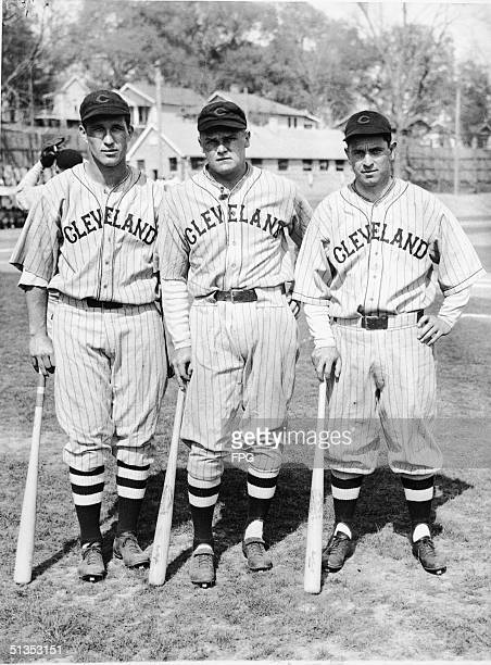 Three members of the Cleveland Indians baseball team pose together with their bats before a preseason game against the New York Giants Tallahassee...