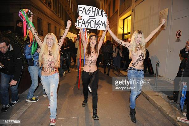 Three members of the feminist movement FEMEN protest at the entrance of the Versace Fallwinter 20122013 show during the Milan Womenswear Fashion Week...