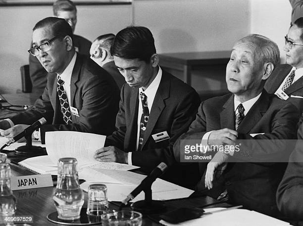 Three members of the Japanese delegation at the annual meeting of the International Whaling Commission, held at River Walk House, Millbank, London,...