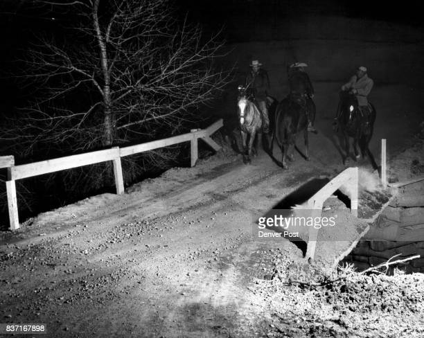 Three members of the Jefferson County Sheriff's Mounted Posse trade queries during their search for Adolph Coors III millionaire head of the Coors...