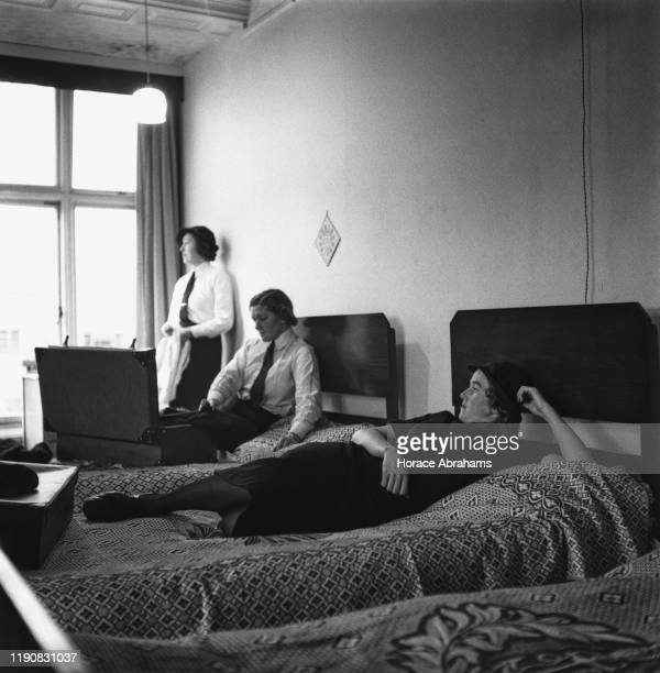 Three members of the WRNS , the women's branch of the Royal Navy, check out their new accommodation after arriving for duty on the 'HMS Daedalus'...