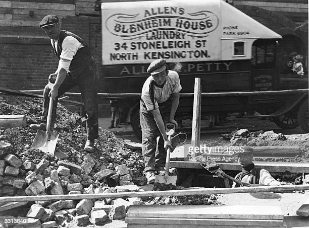 Three men after surviving an accident in which a horse fell into the hole under the road in Ladbroke Grove London in which they were working The...