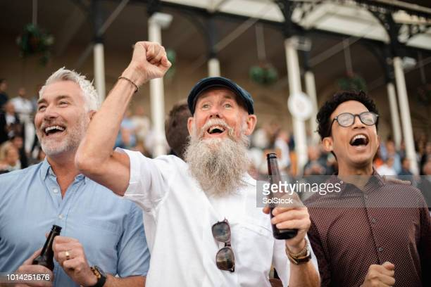 three men celebrating - horse racing stock pictures, royalty-free photos & images
