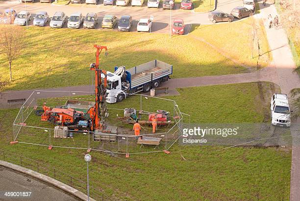 Three Men Drilling Borehole with Mobile Rig