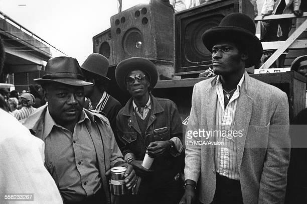 Three men drinking Sound System Notting Hill Carnival London UK 1983