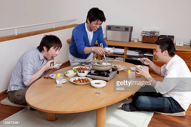 Three men enjoying home party