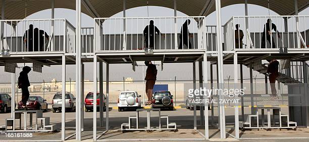 Three men hang from the gallows after being executed by hanging just west of the capital Kuwait City on April 12013 Authorities in Kuwait hanged...