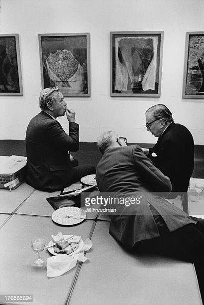 Three men having a picnic on the floor of the Serpentine Gallery in London, 1982.