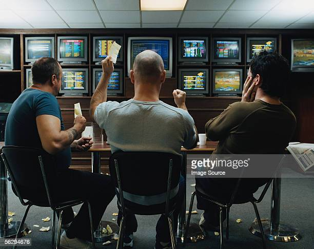 three men in a betting shop - gambling stock pictures, royalty-free photos & images