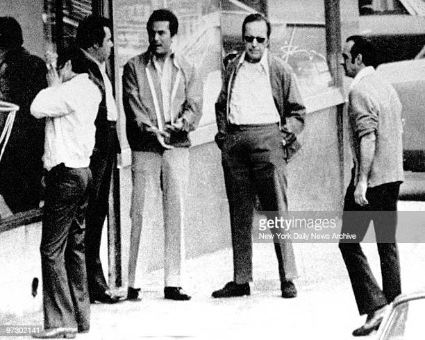 Three men in middle are Angelo Ruggiero John Gotti and Carmine Fatico outside the Bergin Hunt and Fish Club