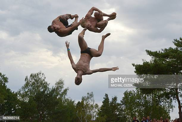 Three men jump from a swing to the lake of the village of Hrimezdice 60 kilometers from Prague during an unofficial Czech outdoor free style jump...