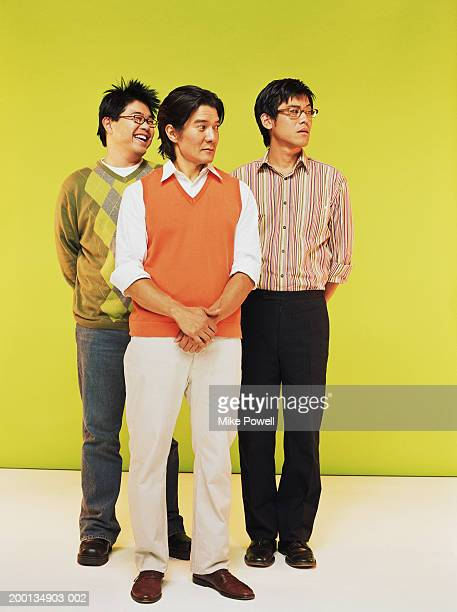 three men looking sideways - sweater vest stock photos and pictures