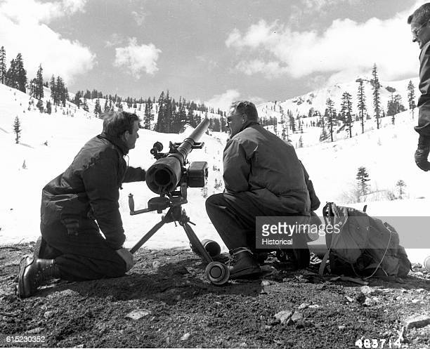 Three men shoot recoilless rifles at snow formations to prevent avalanches at the 1960 Winter Olympic Games at Squaw Valley One of the men Monty...