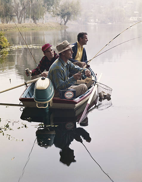 Three men sitting in motorboat and fishing