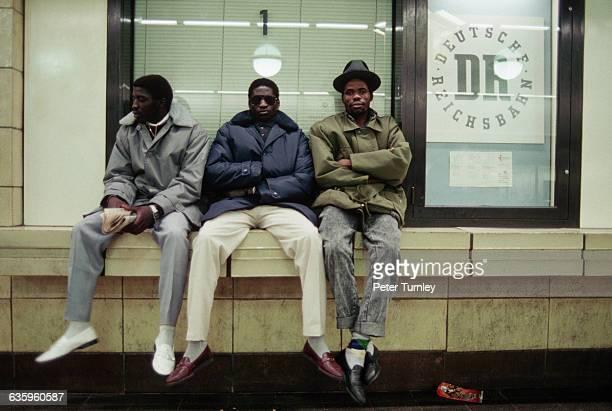 Three Men Sitting on Window Sill