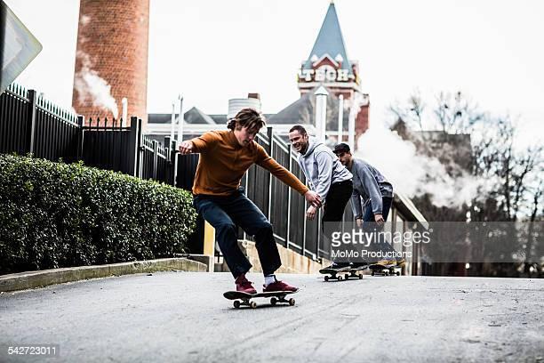 three men skateboarding in urban environment. - atlanta georgia stock pictures, royalty-free photos & images