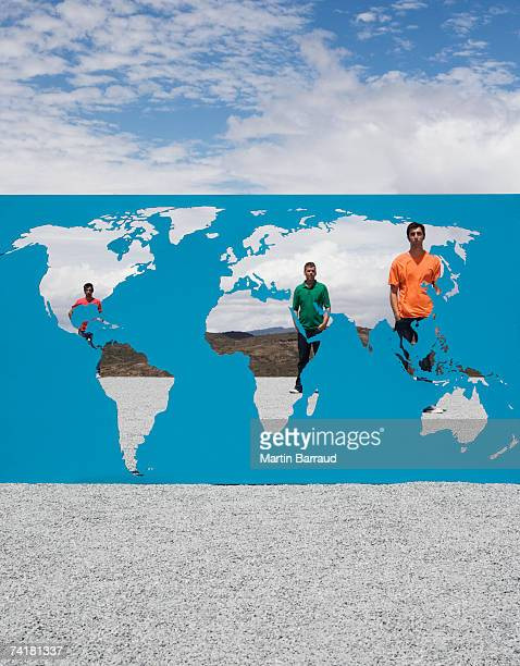 three men standing behind world map outdoors - world kindness day stock photos and pictures