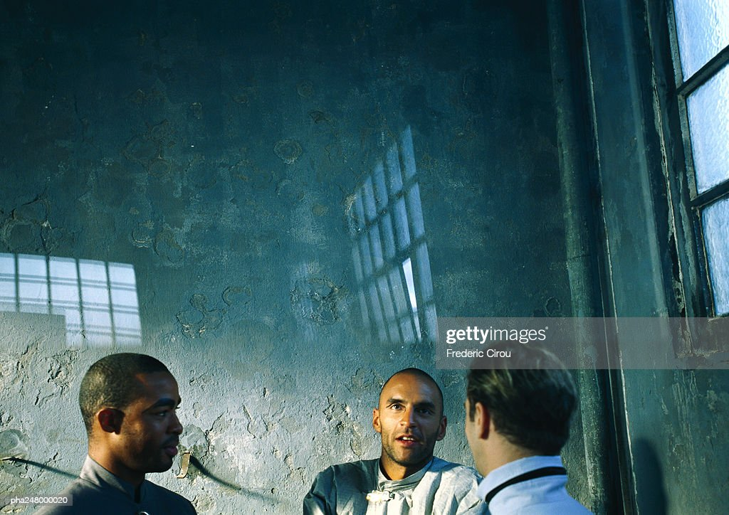 Three men talking : Stock Photo