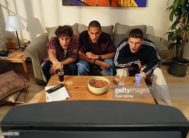 Three Men Watching Television