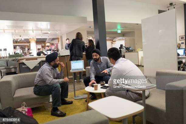 Three men wearing turbans conduct a meeting at SAP HanaHaus co-working space at the Blue Bottle Coffee shop in Silicon Valley, Palo Alto, California,...