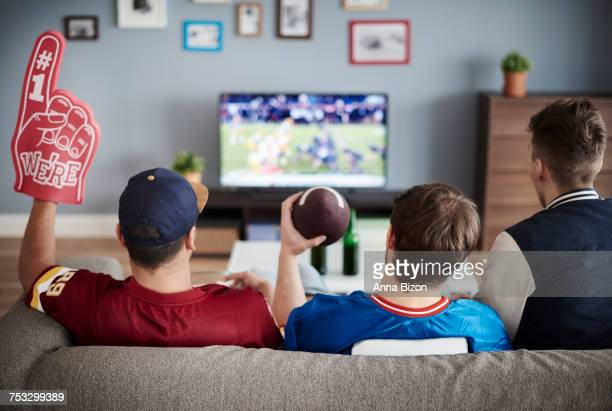 three men with american football equipment. debica, poland - match sport stock pictures, royalty-free photos & images