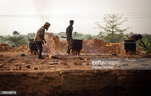 Three men working in a brickyard in a rural region in the southwest of Bangladesh on April 12 2016 in Mongla Bangladesh