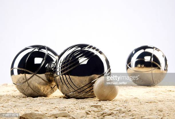 Three metal balls and one  wooden ball