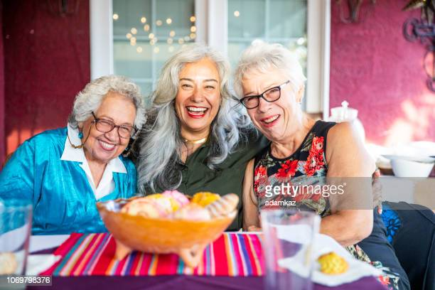 Three Mexican Ladies Smiling with Sweet Bread