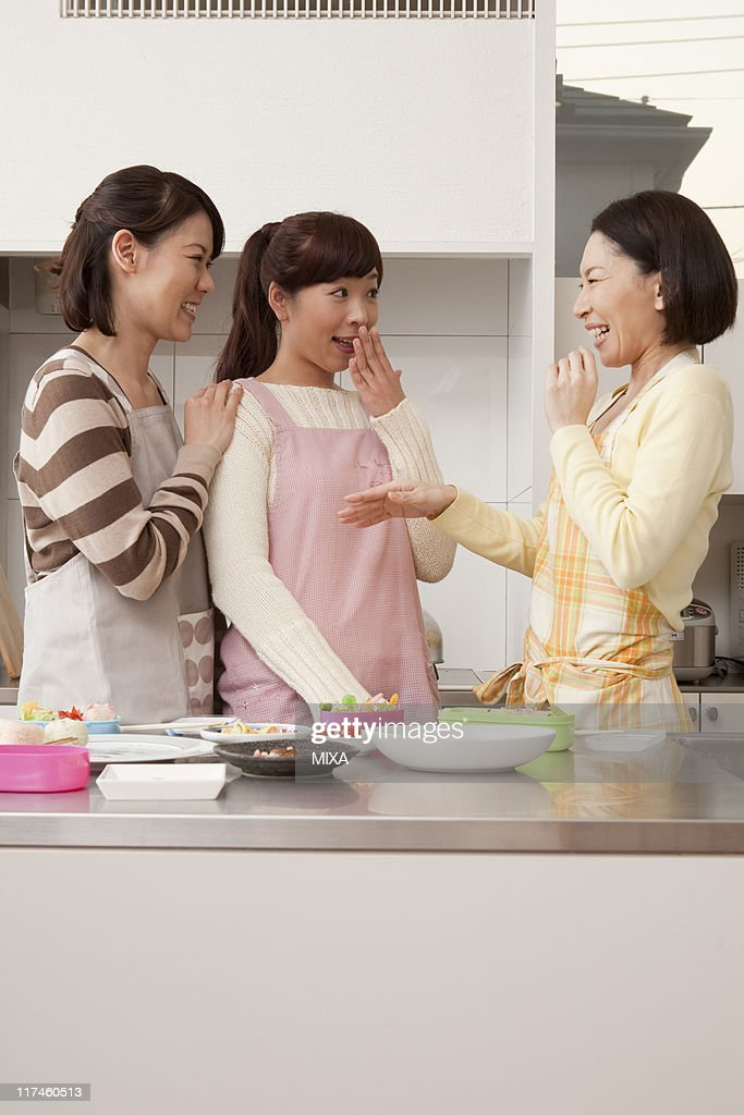 Three mid adult women having a chat : Stock Photo