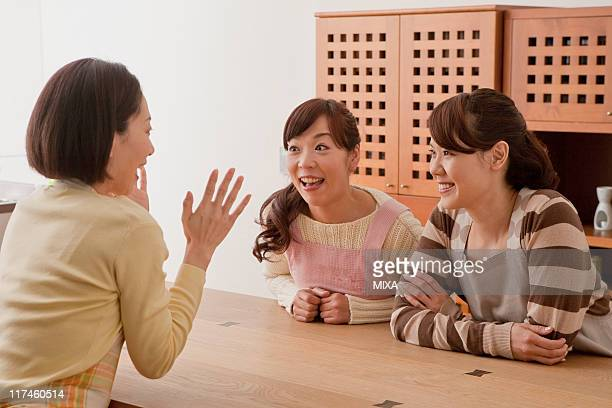 Three mid adult women having a chat
