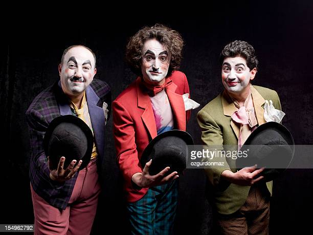 three mimes are greeting the audience - mime stock photos and pictures