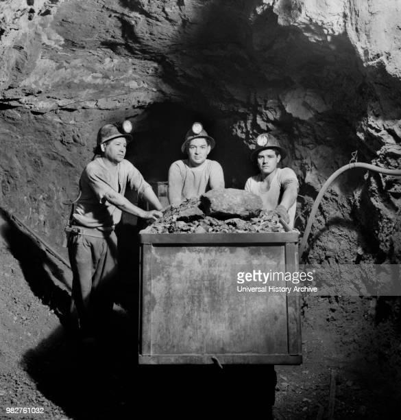 Three Miners Loading Mercury Ore into Mine Car by Hand Quicksilver Mining Company New Idria California USA Andreas Feininger for Office of War...