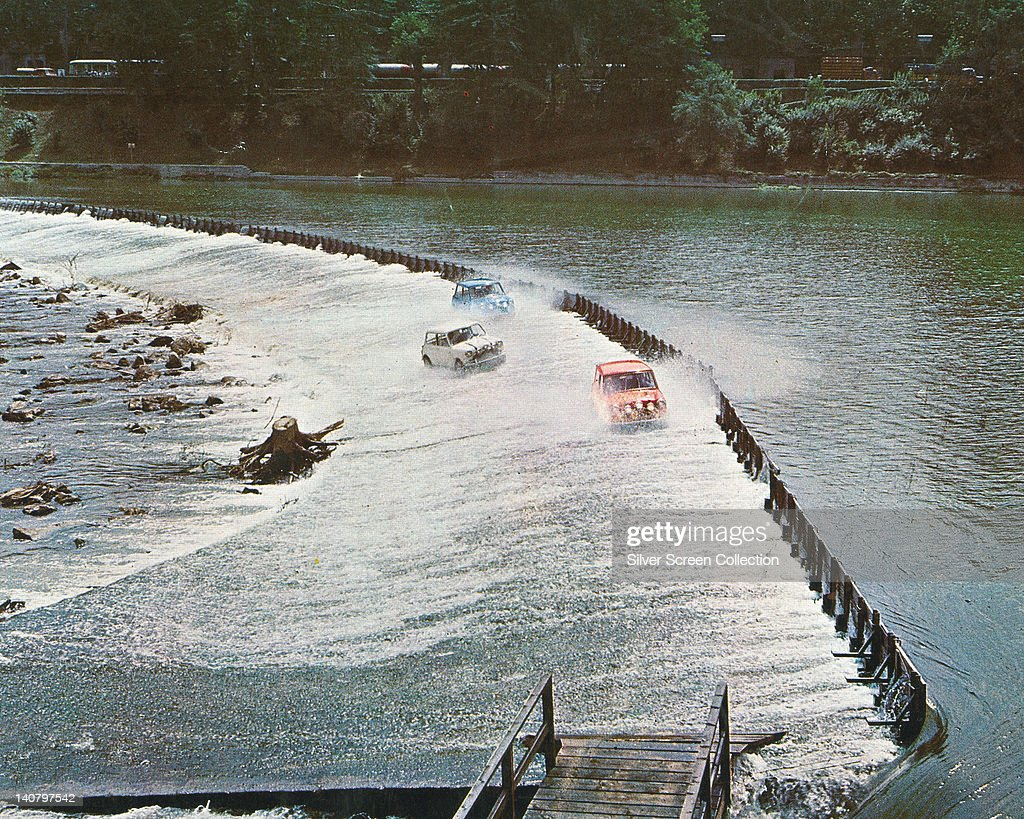 Three Mini Cooper cars crossing a weir over the River Po in Turin in a publicity still issued for the film, 'The Italian Job', Turin, Italy, 1969. The heist film was directed by Peter Collinson (1936-1980).
