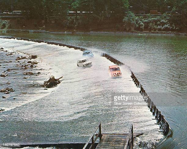 Three Mini Cooper cars crossing a weir over the River Po in Turin in a publicity still issued for the film 'The Italian Job' Turin Italy 1969 The...