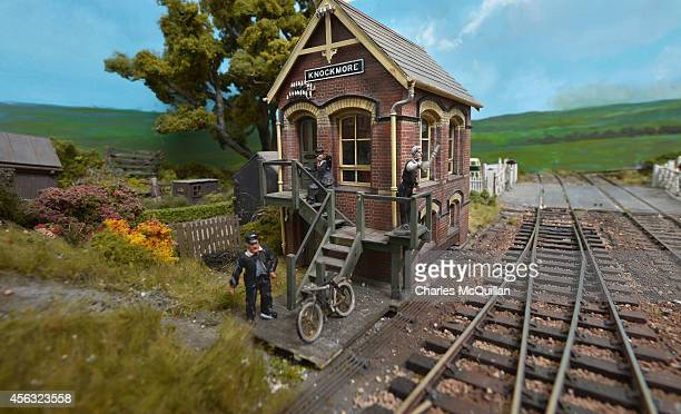 Three miniature station men depicted in a model railway set in the loft after closing time at the Headhunters Barber Shop and Railway Museum on...