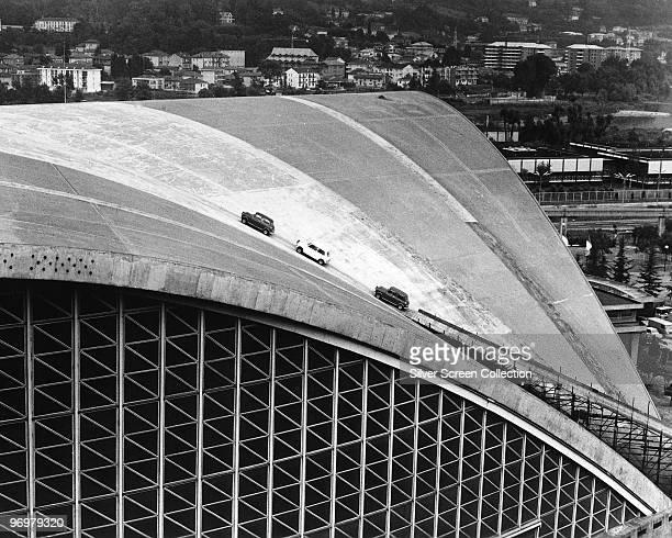 Three minis climb the roof of the Palazzo a Vela in Turin in a scene from the British caper film 'The Italian Job' 1969