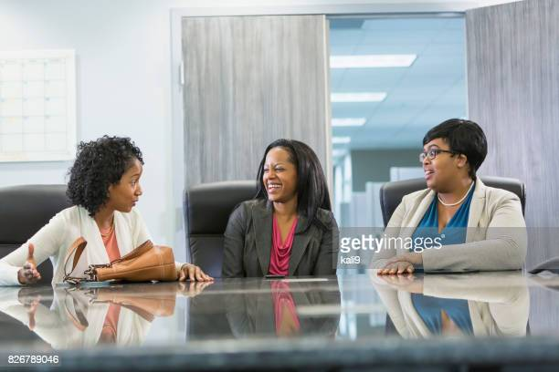 Three minority women getting ready for business meeting